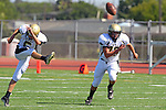 Torrance, CA 09/08/11 - Max MacLeay (Peninsula #5) and Triston Martinez (Peninsula #70) in action during the North-Peninsula Junior Varsity Football game at North High School in Torrance.