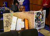 """Paul Njoroge, a father who lost his wife and three children in the crash of on Ethiopia Airlines Flight 302 holds photos of his children and their coffins in a grave prior to Dennis Muilenburg, President and Chief Executive Officer, The Boeing Company and John Hamilton, Vice President and Chief Engineer, Boeing Commercial Airplanes, giving testimony before the United States Senate Commerce, Science, and Transportation on """"Aviation safety and the future of Boeing's 737 MAX"""" on Capitol Hill in Washington , DC on  Tuesday, October 29, 2019.<br /> Credit: Ron Sachs / CNP<br /> (RESTRICTION: NO New York or New Jersey Newspapers or newspapers within a 75 mile radius of New York City)"""