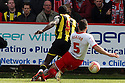 Jon Ashton of Stevenage fouls Clayton Donaldson of Brentford's to concede a penalty. - Stevenage v Brentford - npower League 1 - Lamex Stadium, Stevenage - 21st April, 2012. © Kevin Coleman 2012