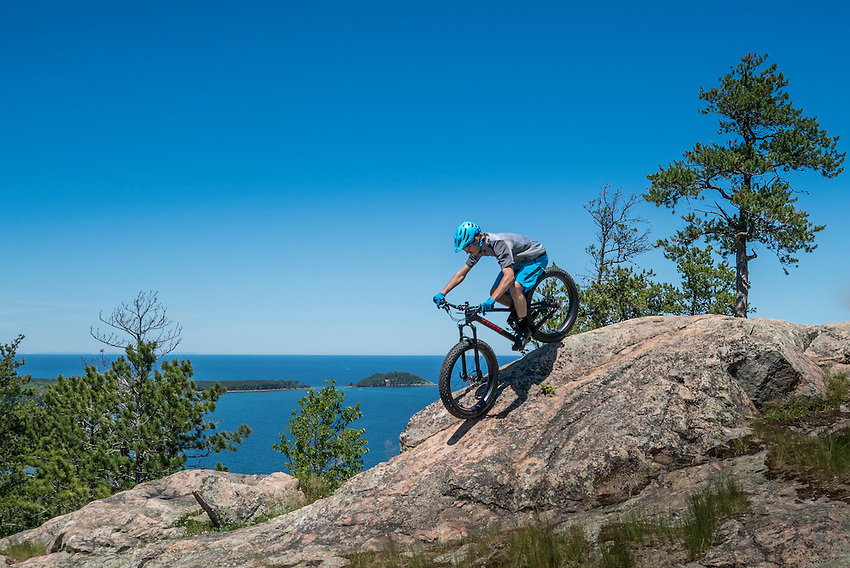 Mountain biking the rugged North Trails in the Harlow Lake area of Marquette, Michigan.