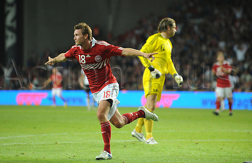 Denmark's goalscorer Mads Junker (L) cheers after his 2-2 goal next to Germany's goalkeeper Tim Wiese during the international soccer match Denmark against Germany in the Parken Stadium in Copenhagen, Denmark, 11 August 2010. The match Denmark against Germany ended up in a tie: 2-2.