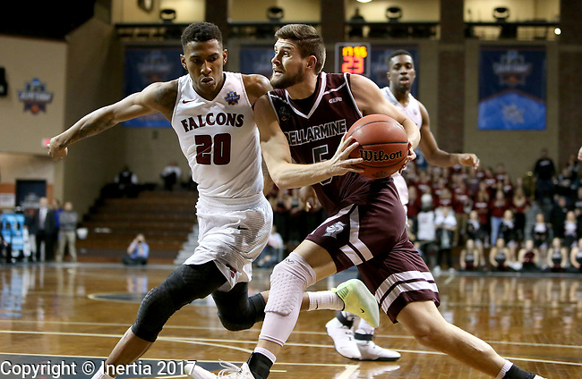 SIOUX FALLS, SD: MARCH 23: Rusty Troutman #5 from Bellarmine looks to drive past Thomas Wimbush #20 from Fairmont State during the Men's Division II Basketball Championship Tournament on March 23, 2017 at the Sanford Pentagon in Sioux Falls, SD. (Photo by Dave Eggen/Inertia)