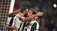Calcio, Champions League: Gruppo H, Juventus vs Lione. Torino, Juventus Stadium, 2 novembre 2016. <br /> Juventus&rsquo; Gonzalo Higuain, left, celebrates with teammates Claudio Marchisio, center, and Miralem Pjanic, after scoring on a penalty kick during the Champions League Group H football match between Juventus and Lyon at Turin's Juventus Stadium, 2 November 2016. The game ended 1-1.<br /> UPDATE IMAGES PRESS/Isabella Bonotto