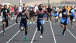 Legacy's Casey Hughes edged out Isaiah Charles of Canyon Springs during the men's 4x100 relay at the Nevada State Track and Field Championships at Damonte High School in Reno, Nev., on Saturday, May 19, 2012. Legacy won the event with a time of 41.71..Photo by Cathleen Allison