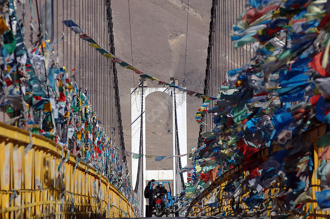 A small tractor crossed a bridge over the river Lhasa strewn with prayer flags just to the east of the Tibetan capital. November 15, 2006