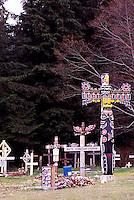 Kwakwaka'wakw (Kwakiutl) Totem Poles in First Nations Cemetery, Alert Bay, Cormorant Island, BC, British Columbia, Canada