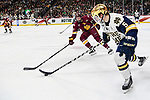 ST PAUL, MN - APRIL 7: Riley Tufte #27 of the Minnesota-Duluth Bulldogs chases as Matt Hellickson #5 of the Notre Dame Fighting Irish skates with the puck during the Division I Men's Ice Hockey Championship held at the Xcel Energy Center on April 7, 2018 in St Paul, Minnesota. (Photo by Tim Nwachukwu/NCAA Photos via Getty Images)