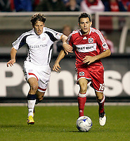 New England midfielder Wells Thompson (7) tries to slow down Chicago Fire midfielder Marco Pappa (16).  The Chicago Fire defeated the New England Revolution 2-0 to win their playoff series at Toyota Park in Bridegview, IL on November 7, 2009.