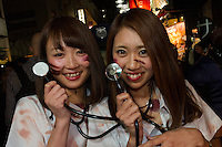 Two Japanese women, dressed as doctors during the Halloween celebrations in Shibuya, Tokyo, Japan. Saturday October 29th 2016 Halloween celebration in Japan have grown massively in the last few years. To ensure the safety of the crowds in Shibuya this year, the police closed several roads leading to the famous Hachiko Square, allowing costumed revellers to spread over a larger area.