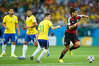 Sami Khedira of Germany skips past Oscar , Hulk and Fred of Brazil