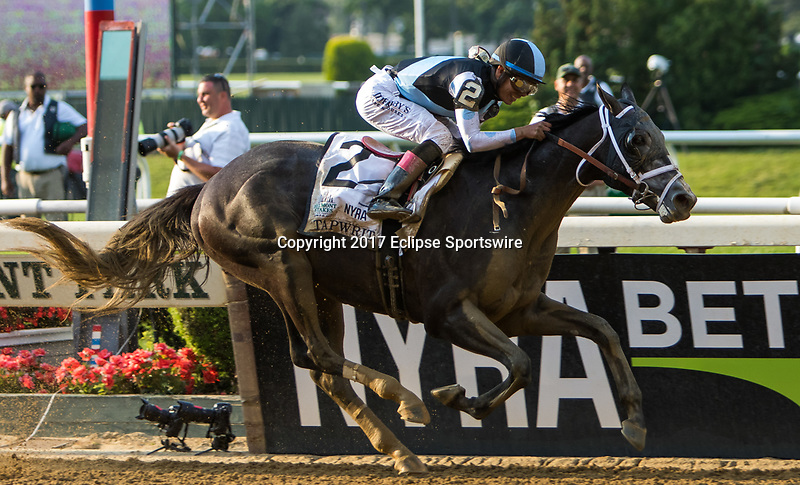 ELMONT, NY - JUNE 10: Tapwrit #2, ridden by Jose Ortiz, wins the 149th Belmont Stakes on Belmont Stakes Day at Belmont Park on June 10, 2017 in Elmont, New York (Photo by Sue Kawczynski/Eclipse Sportswire/Getty Images)