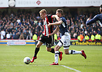 Mark Duffy of Sheffield Utd tackled by Jed Wallace of Millwall during the championship match at the Bramall Lane Stadium, Sheffield. Picture date 14th April 2018. Picture credit should read: Simon Bellis/Sportimage