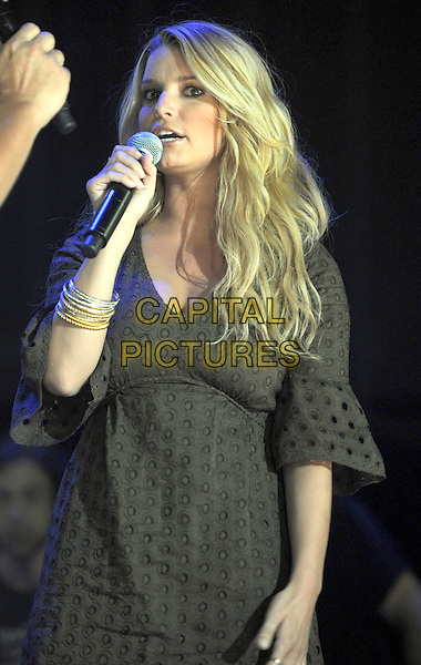 JESSICA SIMPSON.2008 CMA Music Festival Nightly Concert held at LP Field, Nashville, Tennessee, USA..June 5th, 2008.stage concert live gig performance music half length microphone singing brown dress bracelets .CAP/ADM/LF.©Laura Farr/AdMedia/Capital Pictures.