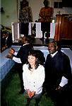 Church of God of Prophecy, woman with her preacher is about to be baptised, London 1990s Uk