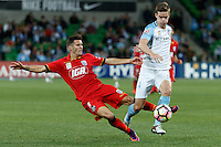 Melbourne, 28 October 2016 - zSERGI GUARDIOLA (9) of Adelaide and CONNOR CHAPMAN (4) of Melbourne City compete for the ball in the round 4 match of the A-League between Melbourne City and Adelaide United at AAMI Park, Melbourne, Australia. Melbourne won 2-1 (Photo Sydney Low / sydlow.com)