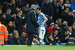 Manuel Pellegrini, manager of Manchester City speaks with Jesus Navas as he is substituted - Manchester City vs Hull City - Capital One Cup - Etihad Stadium - Manchester - 01/12/2015 Pic Philip Oldham/SportImage