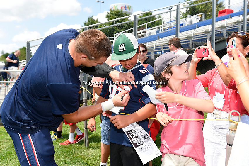 July 29, 2014 - Foxborough, Massachusetts, U.S.- New England Patriots tight end Rob Gronkowski (87) stops to sign autographs for fans during the New England Patriots training camp held at Gillette Stadium in Foxborough Massachusetts.  Eric Canha/CSM