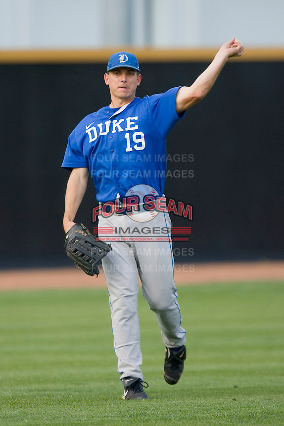 Jeremy Gould #19 of the Duke Blue Devils warms up between innings against the Wake Forest Demon Deacons at the Wake Forest Baseball Park April 23, 2010, in Winston-Salem, NC.  Photo by Brian Westerholt / Sports On Film