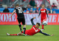 16 April 2011: D.C. United midfielder Dax McCarty #10 and Toronto FC defender Adrian Cann #12 in action during an MLS game between D.C. United and the Toronto FC at BMO Field in Toronto, Ontario Canada..D.C. United won 3-0.