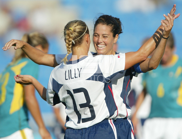 17 August 2004:   Julie Foudy celebrates with Kristine Lilly after Lilly scored a goal during the first half of the game against Australia at Kaftanzoglio Stadium in Thessaloniki, Greece.     USA defeated Australia, 0-0.   Credit: Michael Pimentel / ISI