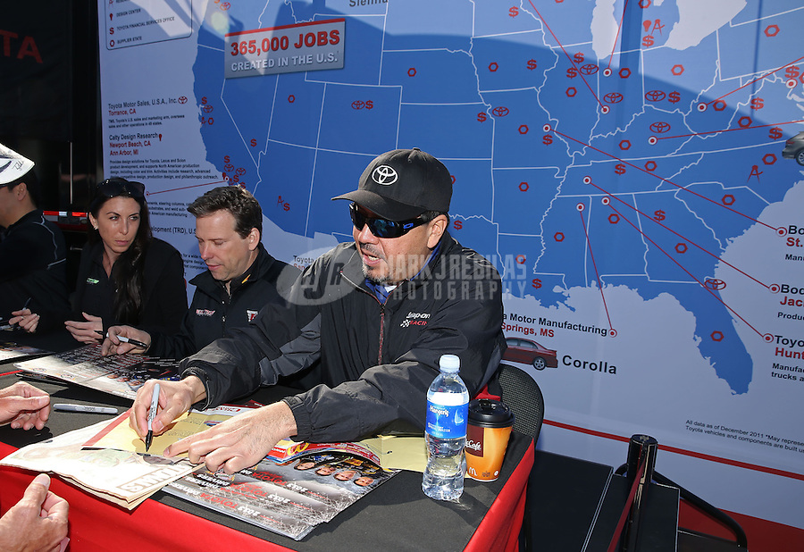 Mar. 15, 2013; Gainesville, FL, USA; NHRA funny car drivers (R-L) Cruz Pedregon, Del Worsham and Alexis DeJoria signing autographs at the Toyota display during qualifying for the Gatornationals at Auto-Plus Raceway at Gainesville. Mandatory Credit: Mark J. Rebilas-