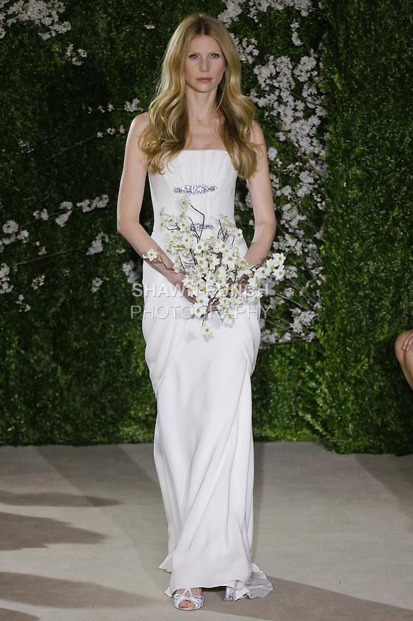Model walks runway in an Audi wedding dresses by Carolina Herrera, for the Carolina Herrera Bridal Spring 2012 runway show.