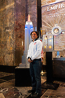Former men's national team player Cobi Jones poses for a photo next to a model of the Empire State Building lit in the Red White and Blue colors of the US Soccer Federation during the centennial celebration of U. S. Soccer in New York, NY, on April 05, 2013.
