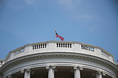 At 12:40 pm EDT on Monday, August 27, 2018, the American Flag is at full staff over the South Portico of the White House in Washington, DC . There has been some controversy if this is showing proper respect for the last United States Senator John McCain (Republican of Arizona).<br /> Credit: Ron Sachs / CNP