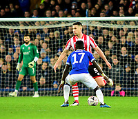 Lincoln City's Jason Shackell clears under pressure from  Everton's Idrissa Gueye<br /> <br /> Photographer Andrew Vaughan/CameraSport<br /> <br /> Emirates FA Cup Third Round - Everton v Lincoln City - Saturday 5th January 2019 - Goodison Park - Liverpool<br />  <br /> World Copyright &copy; 2019 CameraSport. All rights reserved. 43 Linden Ave. Countesthorpe. Leicester. England. LE8 5PG - Tel: +44 (0) 116 277 4147 - admin@camerasport.com - www.camerasport.com
