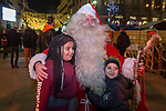 "BRUSSELS - BELGIUM -11 December 2018  -- Christmas market in Brussels features a specialty: the Finnish Village. -- The ""real"" Santa from Finland is posing with Nesserine and Hassan. -- PHOTO: Juha ROININEN / EUP-IMAGES"
