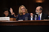 Christine Blasey Ford, the woman accusing Supreme Court nominee Brett Kavanaugh of sexually assaulting her at a party 36 years ago, testifies before the US Senate Judiciary Committee with her Counsels Debra S Katz (L) and Michael R Bromwich (R) on Capitol Hill in Washington, DC, September 27, 2018.  / POOL / SAUL LOEB