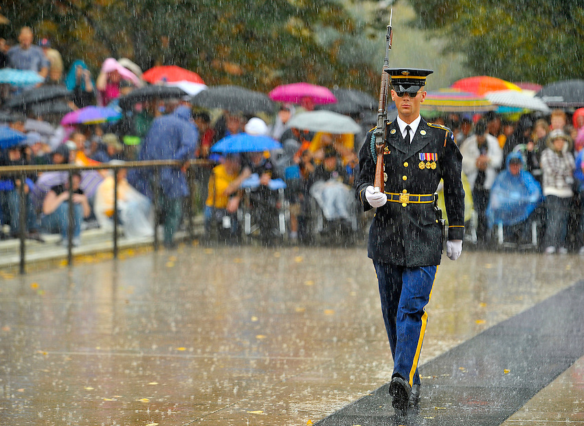 Veterans watched the changing of the guard ceremony in the rain at the Tomb of the Unknowns.  Honor Flight Tennessee Valley #9 trip to Washington, D.C.   Bob Gathany photo.