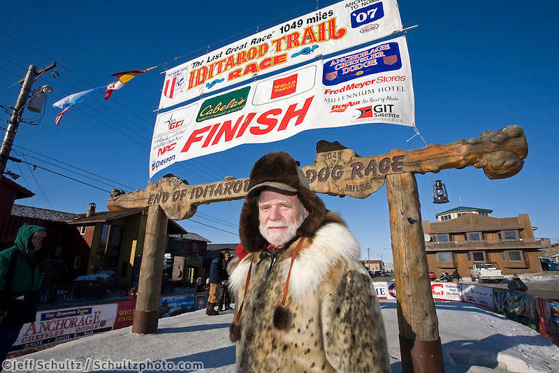 Development director for the Iditarod Trail Comittee Greg Bill stands in front of the finish line in Nome 2007 Iditarod
