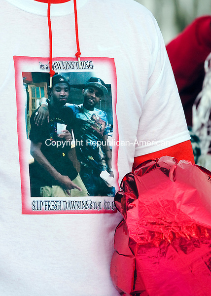 WATERBURY, CT 020714JS19- FEBRUARY 11, 2014_ Family and friends, held a graveside vigil Tuesday at All Saints Cemetery in Waterbury, for Torrance Dawkins, who was killed outside a nightclub in New Haven in August. His mother, Tamara Dawkins, is frustrated because no arrests have been made six months after the shooting. Jim Shannon Republican-American