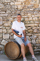 Pierre Ravaille Domaine Ermitage du Pic St Loup, Chateau Ste Agnes. Pic St Loup. Languedoc. Owner winemaker. France. Europe. Bottle.