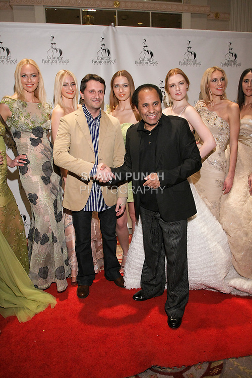 Fashion designers Edward Arsouni and Andres Aquino (black jacket) pose with models pose on red carpet after the Edward Arsouni fashion show, during Couture Fashion Week Fall 2011.