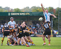 Craig Gillies of Worcester Warriors blocks the box kick of Joe Simpson of London Wasps during the Aviva Premiership match between London Wasps and Worcester Warriors at Adams Park on Sunday 7th October 2012 (Photo by Rob Munro)