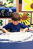 MR / Schenectady, NY.Yates Arts Magnet School / Pre-K.Boy (4) uses shaving cream for art activity. (PK-original).MR: Sit6.© Ellen B. Senisi
