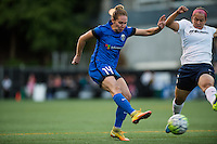 Seattle, Washington -  Sunday, September 11 2016: Seattle Reign FC forward Manon Melis (14) takes a shot on goal during a regular season National Women's Soccer League (NWSL) match between the Seattle Reign FC and the Washington Spirit at Memorial Stadium. Seattle won 2-0.