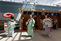 Three women dressed in kimono play traditional musical instruments during the Edo festival at Haneda International Airport terminal, Tokyo, Japan. Friday August 26th 2016. The 3 day festival runs from August 26th to August 28th at Tokyo's second International airport. Actors dressed as samurai, geisha and ninja will greet passengers and visitors to the terminal and put on shows and parades of traditional music and dance. Haneda International airport has an Edo theme. Edo is the old name for Tokyo in the time of the samurai
