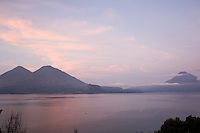 Lake Atitlan at dawn, showing all three of the volcanoes San Pedro, Toliman and Atitlan.