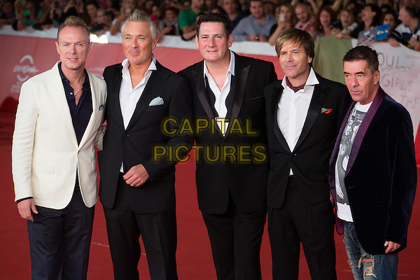 ROME, ITALY - OCTOBER 20: Members of Spandau Ballet pop band (from left) Martin Kemp, John Keeble, Tony Hadley, George Hencken, Steve Norman, Gary Kemp pose during the red carpet<br />  of the documentary 'Soul Boys of the Western World' presented during the 9th Rome Film Festival on October 20, 2014 in Rome, Italy.<br /> CAP/IND/LC<br /> &copy;LC/IND/Capital Pictures