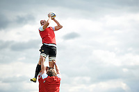 Matt Garvey of Bath Rugby wins the ball at a lineout. Bath Rugby training session on September 4, 2015 at Farleigh House in Bath, England. Photo by: Patrick Khachfe / Onside Images
