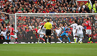 Pictured: Wayne Rooney (2nd L) of Manchester United scoring his equaliser making the score 1-1. Saturday 16 August 2014<br />