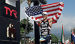 KAILUA-KONA, HI - OCTOBER 13:  Andy Potts of the USA crosses the finish line during the 2012 IRONMAN World Championships on October 13, 2012 in Kailua-Kona, Hawaii. (Photo by Brandon Magnus)
