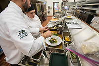 Chef Noah Miller instructs Culinary Arts student Shelby Boos during Miller's A la Carte Kitchen and Culinary Skill Development laboratories in Lucy Cuddy Hall's Bakery.