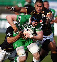 Wellington number eight Matthew Luamanu (top) tries to tackle James Good during the Air NZ Cup preseason match between Manawatu Turbos and Wellington Lions at FMG Stadium, Palmerston North, New Zealand on Friday, 17 July 2009. Photo: Dave Lintott / lintottphoto.co.nz