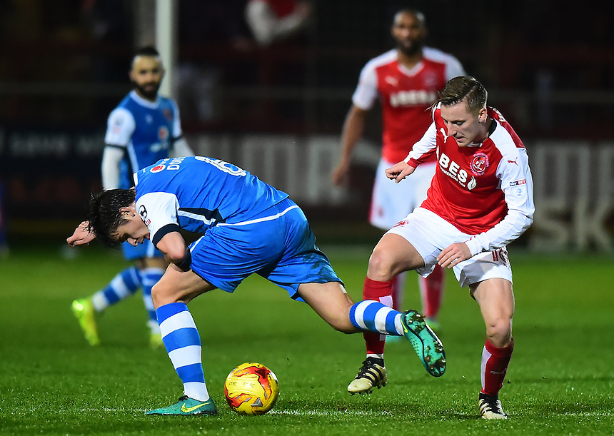 Fleetwood Town's George Glendon competes with Walsall's George Dobson<br /> <br /> Photographer Richard Martin-Roberts/CameraSport<br /> <br /> The EFL Sky Bet League One - Fleetwood Town v Walsall - Saturday 10th December 2016 - Highbury Stadium - Fleetwood<br /> <br /> World Copyright &copy; 2016 CameraSport. All rights reserved. 43 Linden Ave. Countesthorpe. Leicester. England. LE8 5PG - Tel: +44 (0) 116 277 4147 - admin@camerasport.com - www.camerasport.com