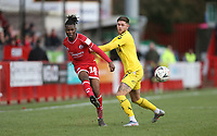 Fleetwood Town's Wes Burns and Crawley Town's David Sesay<br /> <br /> Photographer Rob Newell/CameraSport<br /> <br /> Emirates FA Cup Second Round - Crawley Town v Fleetwood Town - Sunday 1st December 2019 - Broadfield Stadium - Crawley<br />  <br /> World Copyright © 2019 CameraSport. All rights reserved. 43 Linden Ave. Countesthorpe. Leicester. England. LE8 5PG - Tel: +44 (0) 116 277 4147 - admin@camerasport.com - www.camerasport.com
