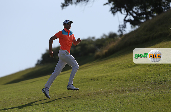 Charl Coetzee (RSA) leaps across the 18th fairway during Round Three of The Africa Open 2014 at the East London Golf Club, Eastern Cape, South Africa. Picture:  David Lloyd / www.golffile.ie